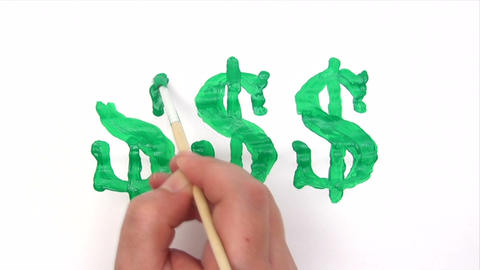 Painting Green Dollar Signs - Time Lapse Footage