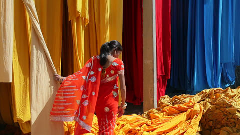 Woman in Saree checking the quality of freshly dye Footage