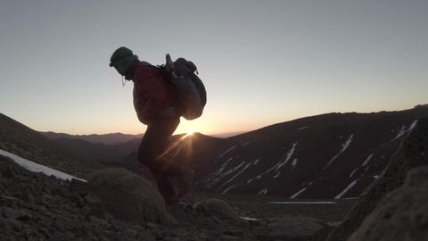 Silhouetted Mountain Climber at Sunrise - FT0002 Footage
