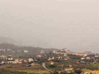Village in mountain valley fog hides. Sicily, Ital Footage