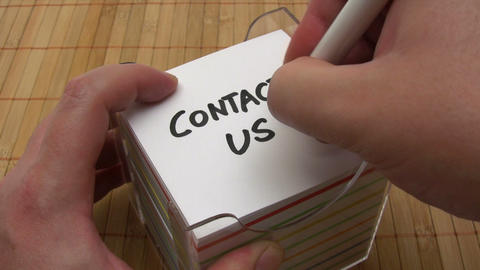 Writing A Contact Us Note stock footage