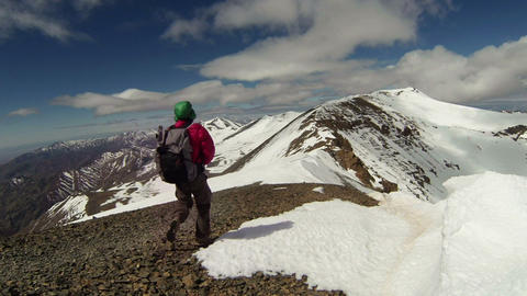 Climber Reaches Snowy Peak, Morocco - FT0024 stock footage