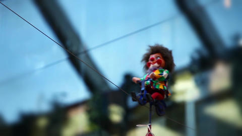 Clown On Bike Rides Along The Rope stock footage