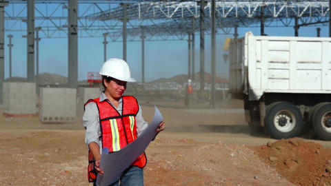 Female Building Engineer with Schematics Footage
