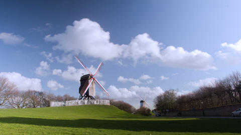 Beautiful Wooden Wind Mill Brugge, Belgium. Time L stock footage