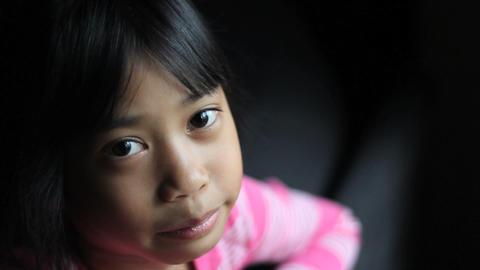 Little Asian Girl Breaks Into Big Smile Footage