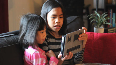 Little Asian Girls Having Fun With New Tablet Footage