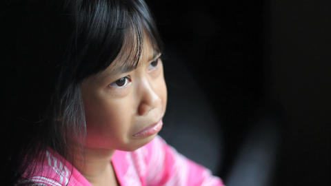 Sad Little Asian Girl Stares Out The Window Footage