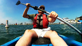 Middle Aged Man Kayaking By Yachts & Boats stock footage