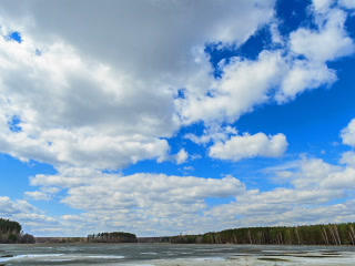 Clouds over the lake. Last snow. Time Lapse. 320x2 Footage