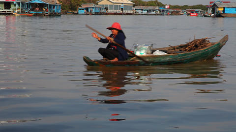Woman floating in a boat Footage