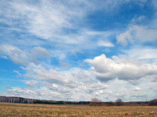 Clouds over the field. Early Spring. 320x240 Footage