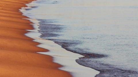 sea waves and sand beach at sunrise Footage