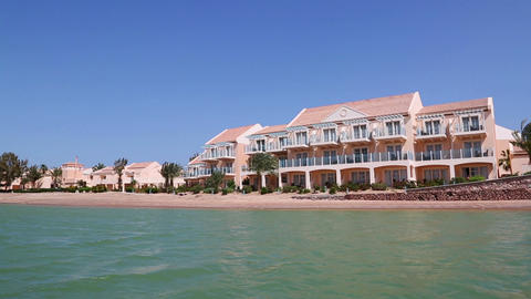 View of houses and hotels from boat floating on ch Footage