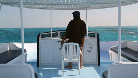 Captain At Controls On Yacht In Sea stock footage