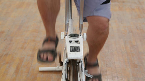 overweight woman exercising legs on bike simulator Footage