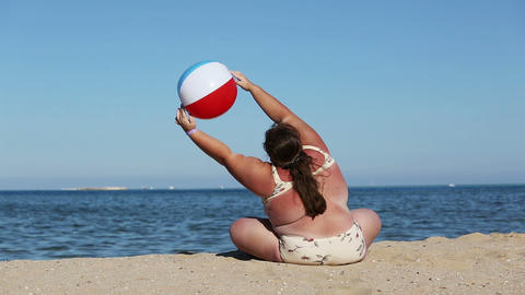 Overweight Woman Doing Gymnastics On Beach stock footage