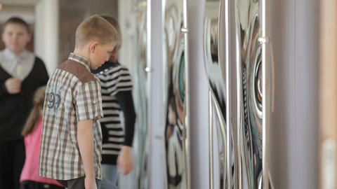 Children looking in the funhouse mirrors Footage