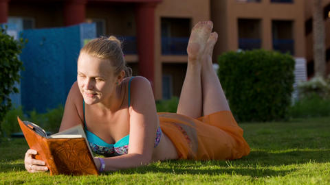 Relaxation with reading on resort Footage