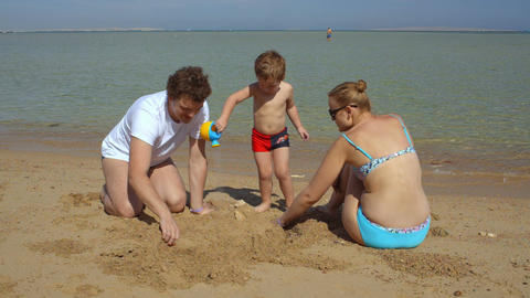 Happy family on the beach Footage