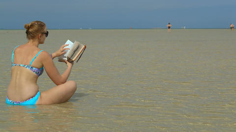 Relaxing and reading in the water Footage
