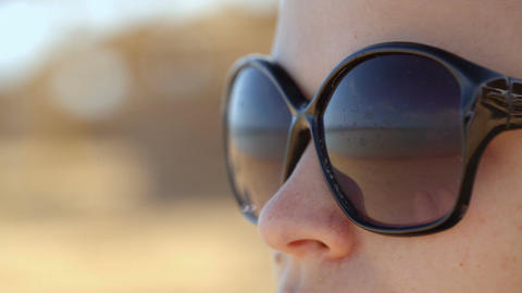 Woman in sunglasses Footage