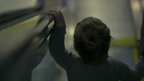 Boy on the escalator going down Footage
