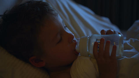 Boy drinking milk before bedtime Footage
