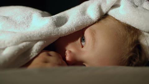 Boy under the towel Footage