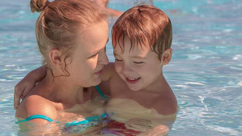 Family fun in the swimming pool Footage