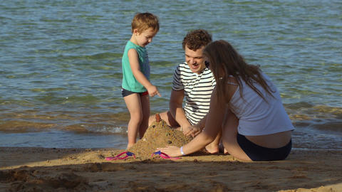 Family Spending Time By The Sea stock footage