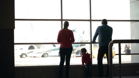 Young family watching planes at an airport Footage
