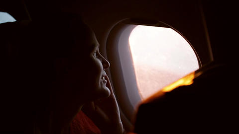 Woman talking on the phone in the plane Footage