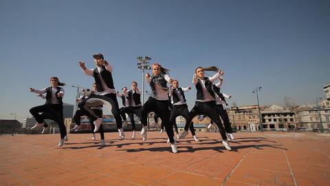Hip-Hop breakdancer dancing in the street on Mart Footage