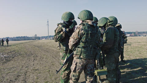 Soldiers With Weapons Are Speaking stock footage