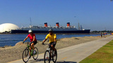 Bike Riding Young Couple Queen Mary In Background stock footage