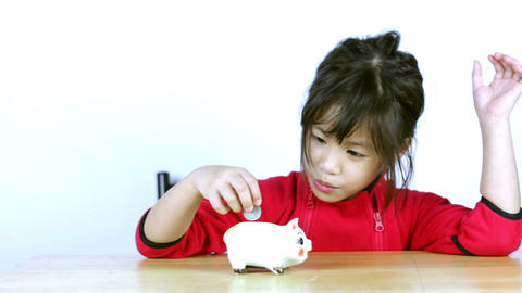 Cute Asian girl save money in picklet bank Footage