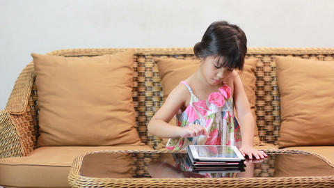 Little asian girl playing tablet Footage