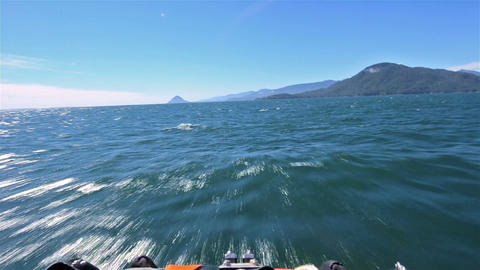 Point of view from a zodiac bow moving fast across Live Action