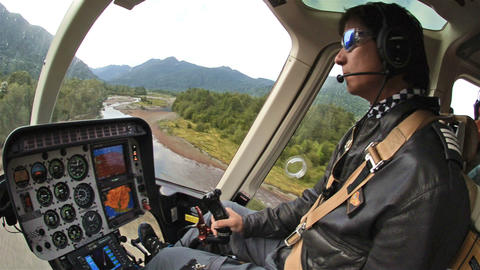 Pilot Taking Off In A Helicopter From The Huequi R stock footage
