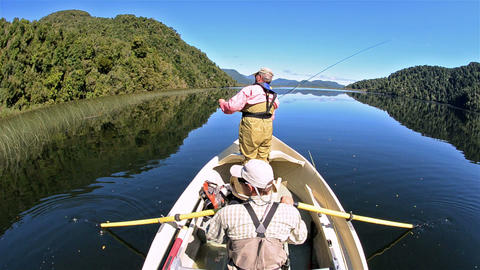 Two men on a fly-fishing adventure on Ceasar Lake Stock Video Footage