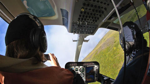 Passenger and pilot in a helicopter flying over th Footage