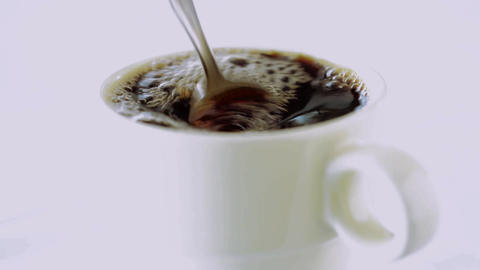 Coffee is stirred in a cup Footage