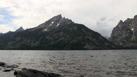 A beautiful lake in front of the Grand Tetons moun Footage