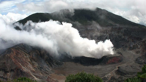 The Poas volcano in Costa Rica smokes and steams Footage