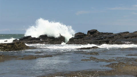 Ocean waves crash on the rocks of a beach Footage