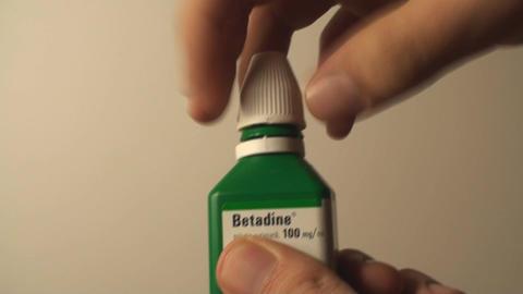 Man Opening A Bottle Of Betadine, Injury, Bandage, Footage