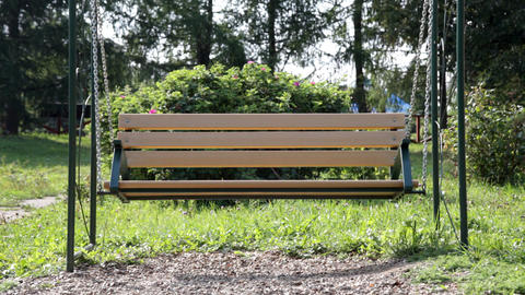 Bench empty swing in park Stock Video Footage