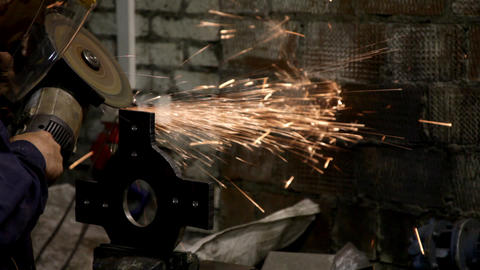 Man work with metal detail - sparkles fly out Stock Video Footage