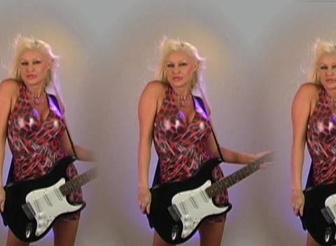 Beautiful Blonde with Electric Guitar - in Triplic Stock Video Footage